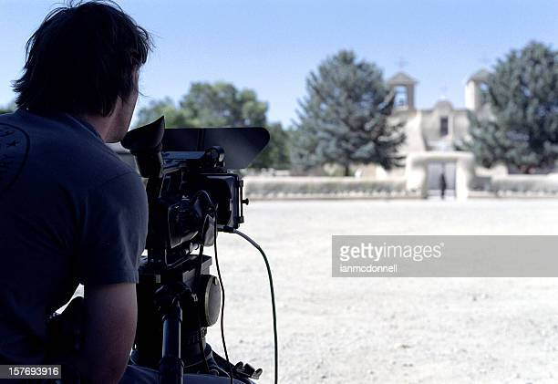 Man using professional camera to shoot the landscape