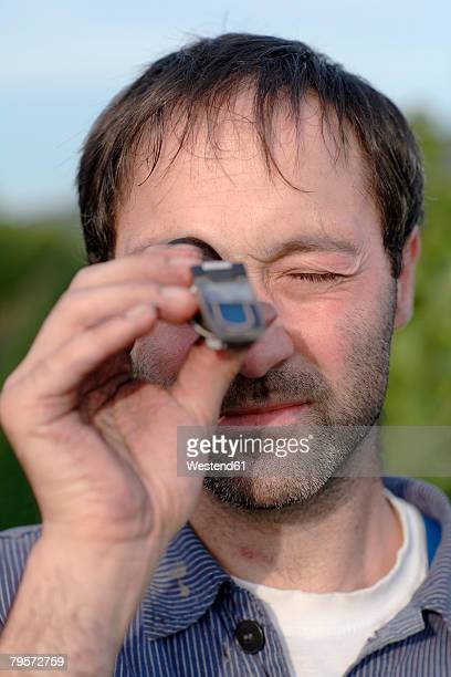 Man using refractometer