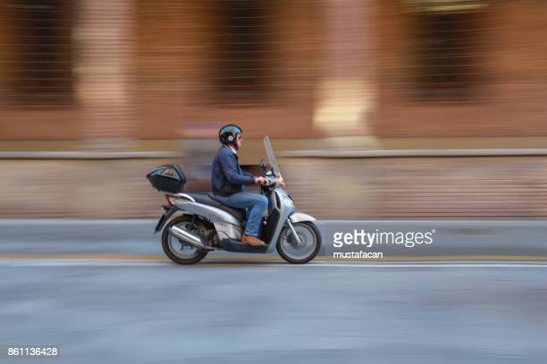 man using scooter in the city - moped stock photos and pictures
