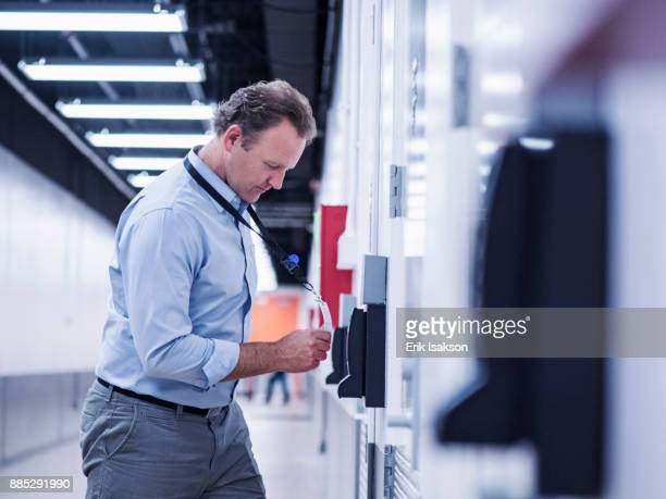 man using security card to enter room in data center - sensor stock pictures, royalty-free photos & images