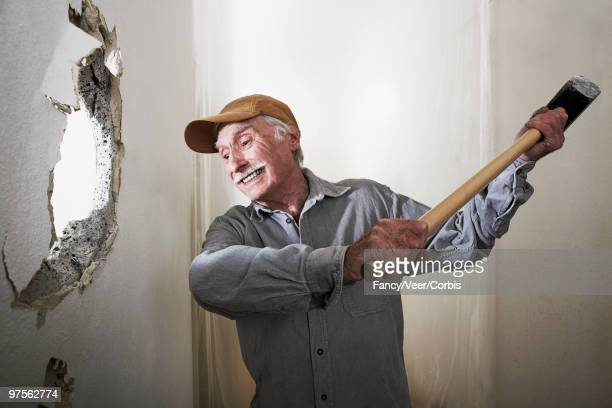 Man using sledgehammer