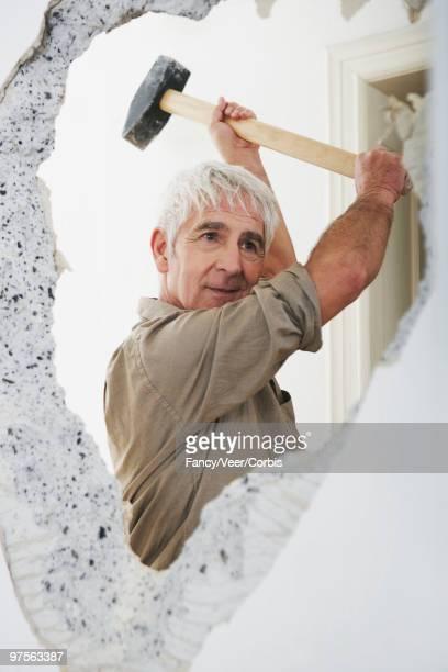 Man using sledgehammer
