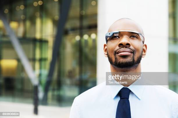 Man using smart glasses in financial district