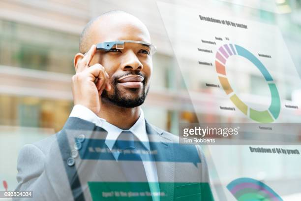 Man using smart glasses with screen overlay