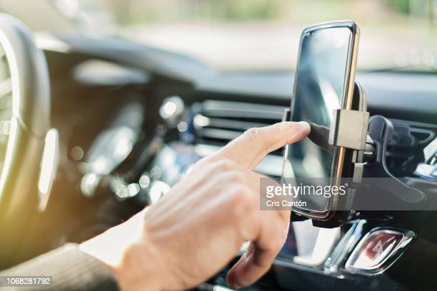 man using smart phone in car - dashboard stock pictures, royalty-free photos & images