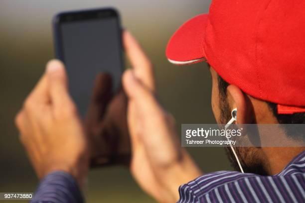 A man using smart phone