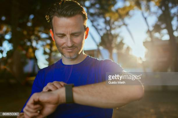 Man using smart watch after running.