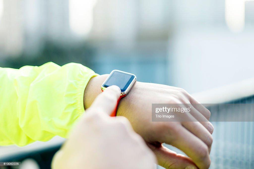 man using smart watch outdoors after jogging : Foto de stock