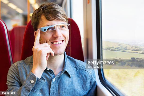 Man using Smart-Glass on train.