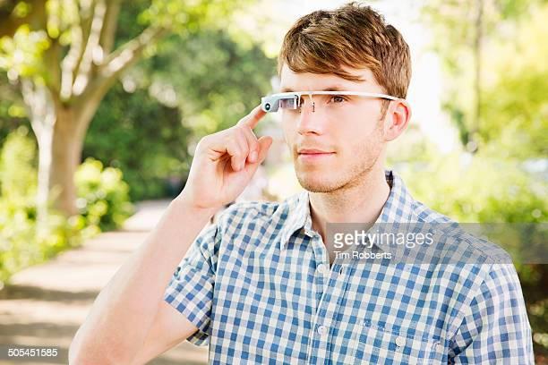 Man using Smart-Glass outside.