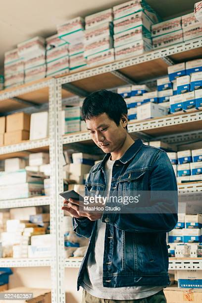 Man using smartphone at hardware store