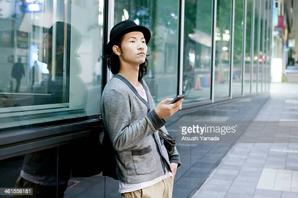 Man using smartphone in city location