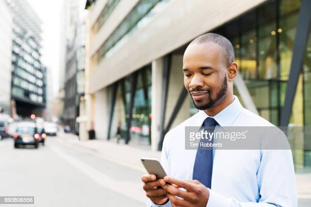 Man using smartphone in financial district
