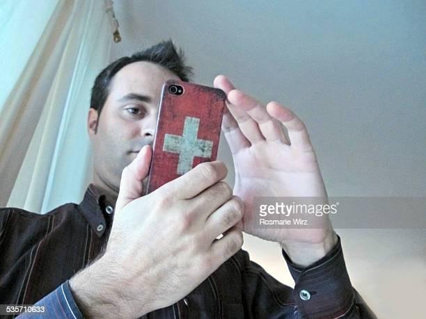 Man using smartphone indoors