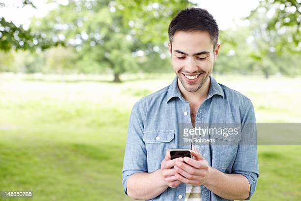 Man using smartphone outside.