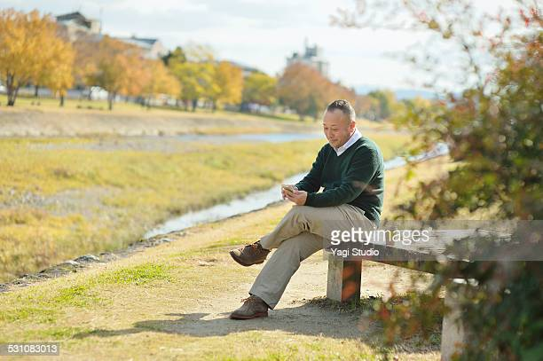 Man using smartphones beside the river