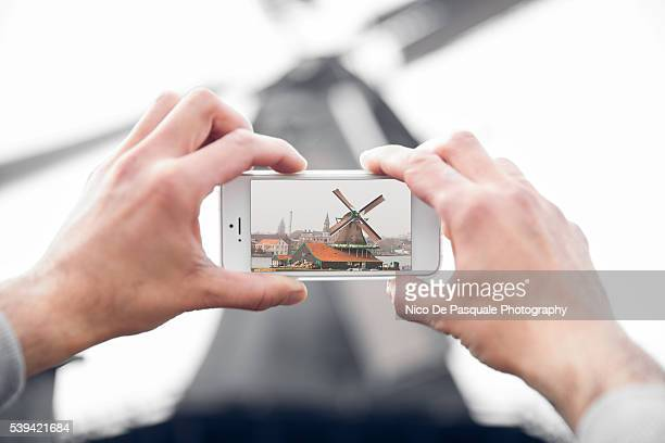 Man using smatphone to take pictures