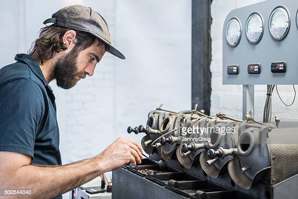 Man using specialist equipment in coffee roasting warehouse