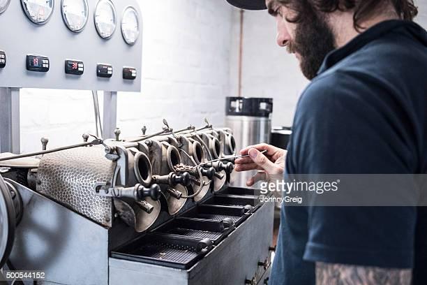 Man using specialist gourmet coffee roasting equipment