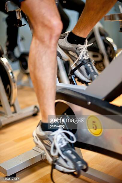 Man using spin machine in gym