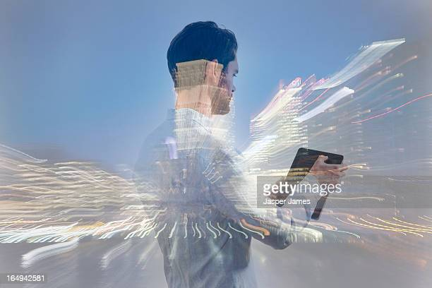 man using ipad and cityscape