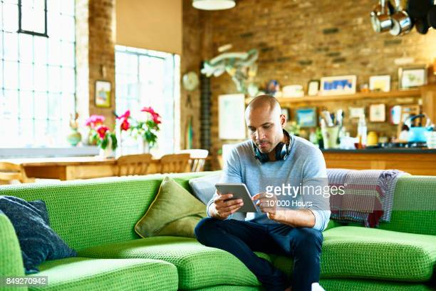 man using tablet - using digital tablet stock pictures, royalty-free photos & images