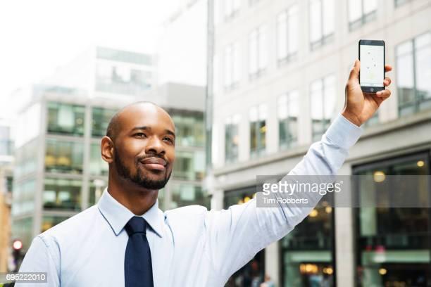 Man using taxi app