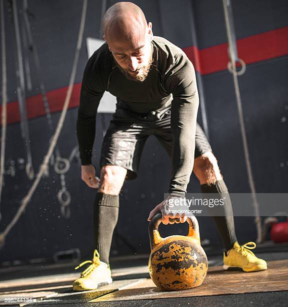 man using the kettlebell on the gym - human limb stock pictures, royalty-free photos & images