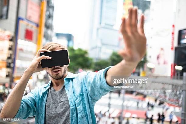 man using the VR simulator in Tokyo - Shibuya