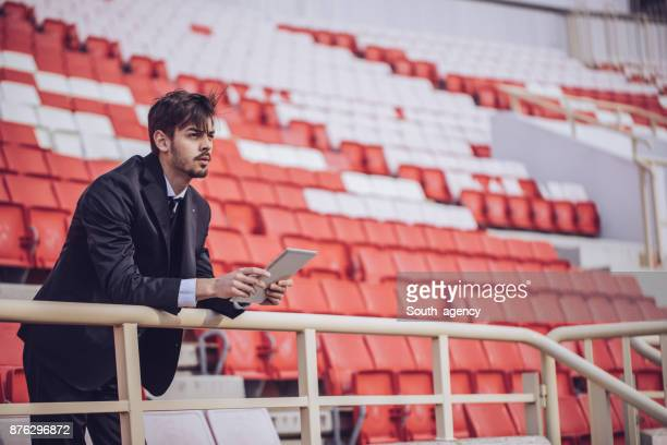 man using touchpad on stadium - sportkleding stock pictures, royalty-free photos & images
