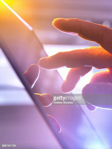 Man using touchscreen device, close-up