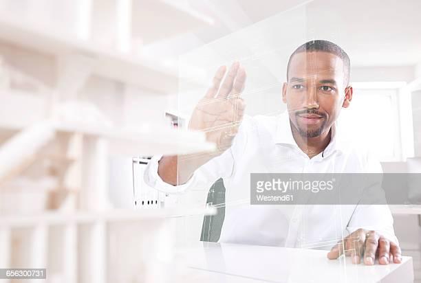 man using transparent touchscreen display - berührungsbildschirm stock-fotos und bilder