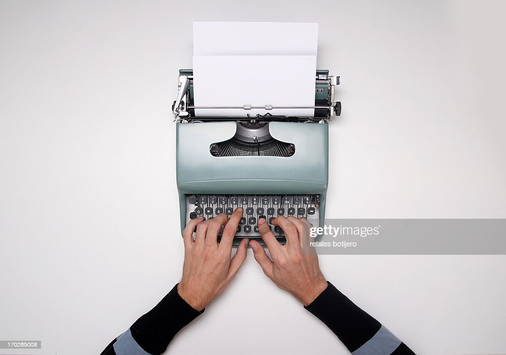 man using typewriter : Stock Photo