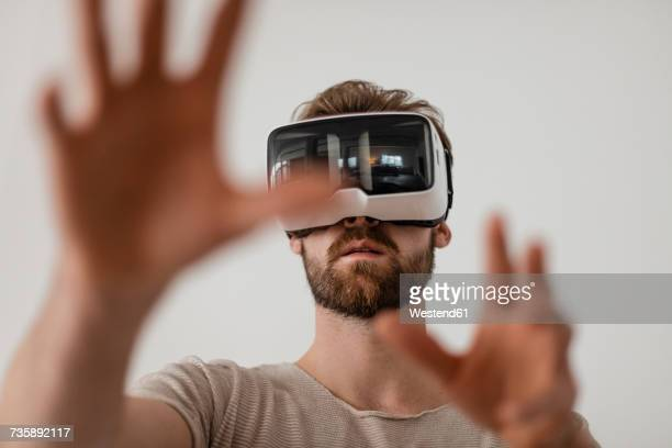 man using virtual reality glasses - virtual reality simulator stock photos and pictures