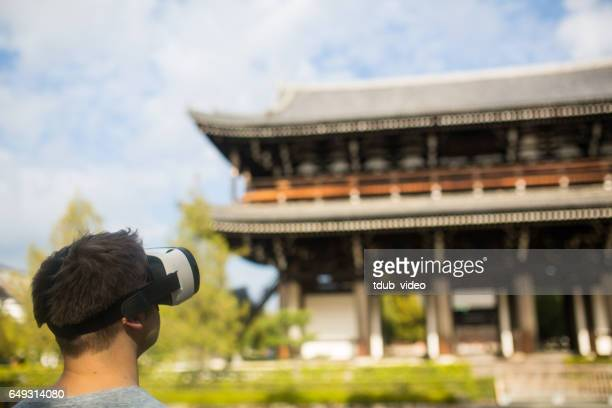 Man using virtual reality headset at a Japanese temple