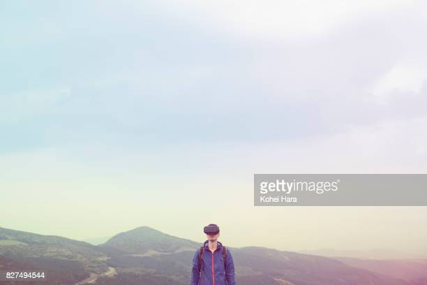 Man using virtual reality headset in the visionary mountain