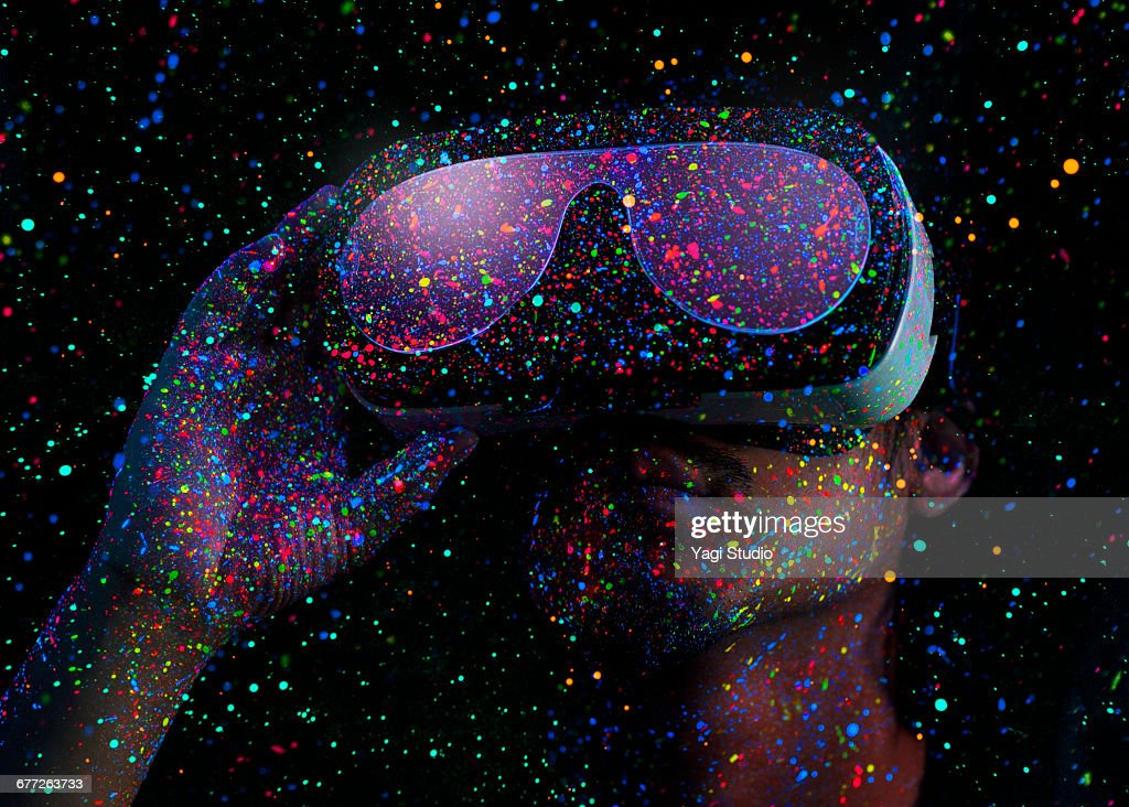 Man using virtual reality headset with Black Light : ストックフォト