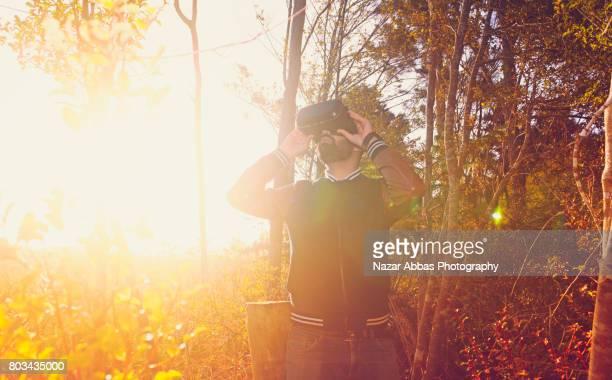 Man Using Virtual Reality Simulator Outdoor.