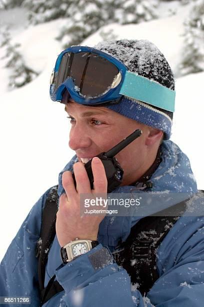Man using walkie-talkie in snow