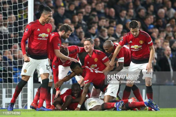 Man Utd celebrate their 2nd goal scored by Paul Pogba who lays at the bottom of the pile during the FA Cup Fifth Round match between Chelsea and...