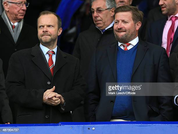 Man Utd Chief Executive Ed Woodward and Group Managing Director Richard Arnold look on prior to the Barclays Premier League match between Everton and...