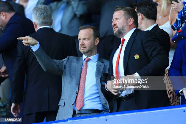 Man Utd Chief Executive Ed Woodward gestures to Man Utd Group Managing Director Richard Arnold before the Premier League match between Everton and...