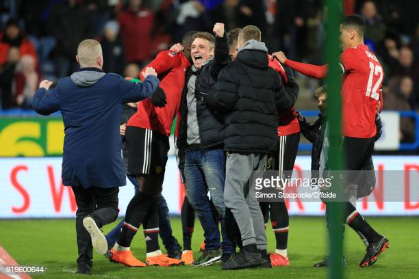 Man Utd fans celebrate their side's 2nd goal during The Emirates FA Cup Fifth Round match between Huddersfield Town and Manchester United at the John...