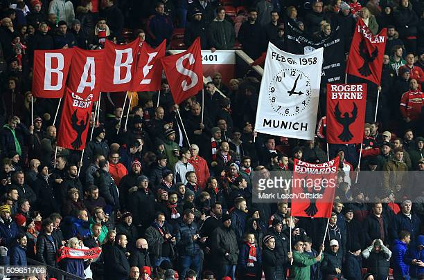 Man Utd fans hold up banners in memory of the victims of the Munich Air Disaster during the Barclays Premier League match between Manchester United...