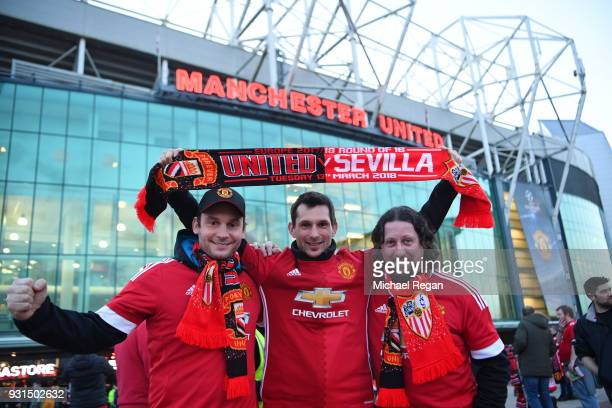 Man Utd fans pose outside the stadium prior to the UEFA Champions League Round of 16 Second Leg match between Manchester United and Sevilla FC at Old...