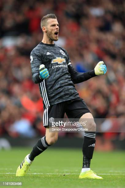 Man Utd goalkeeper David De Gea celebrates during the Premier League match between Manchester United and Chelsea at Old Trafford on August 11 2019 in...