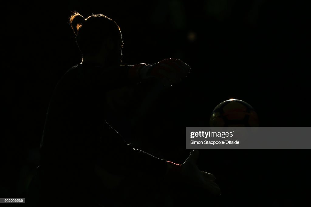 Man Utd goalkeeper David De Gea is silhouetted during the Premier League match between Manchester United and Chelsea at Old Trafford on February 25, 2018 in Manchester, England.