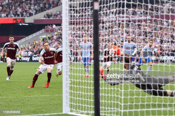 Man Utd goalkeeper David De Gea saves the penalty of Mark Noble of West Ham to deny them an equaliser during the Premier League match between West...