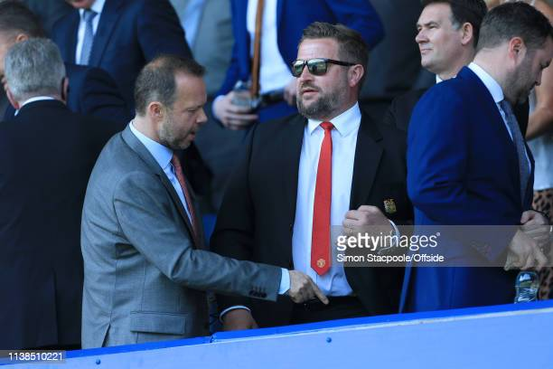 Man Utd Group Managing Director Richad Arnold stands next to Man Utd Chief Executive Ed Woodward during the Premier League match between Everton and...