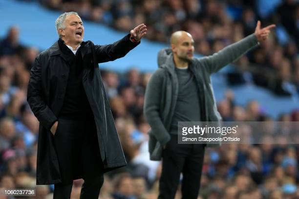 Man Utd manager Jose Mourinho and Man City manager Pep Guardiola gesture during the Premier League match between Manchester City and Manchester...